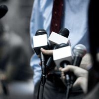 journalists holding microphones