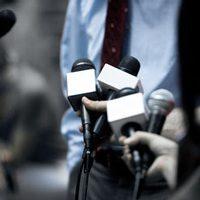 journalists holding microphones